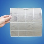 Man holding very dirty air conditioner filter with clipping path